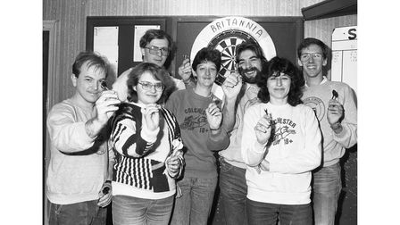 People taking part in a darts marathon at the Britannia pub in Colchester in February 1988