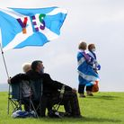 People take part in the All Under One Banner Scottish independence demonstration at the Robert the B