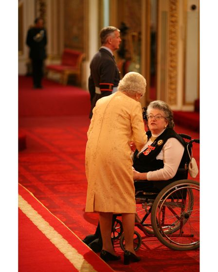 Johanna Beumer receiveing her MBE from The Queen at Buckingham Palace in 2007