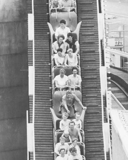 Passengers on the Yarmouth Pleasure Beach roller coaster hang on as the train plummets down one of t