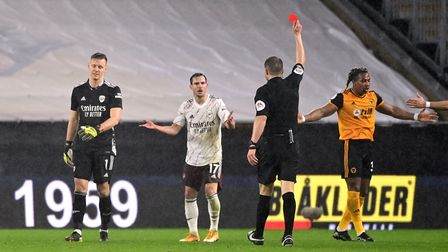 Arsenal goalkeeper Bernd Leno trudges off after being shown a red card