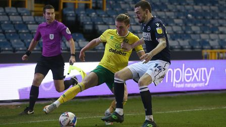 Przemyslaw Placheta of Norwich and Scott Malone of Millwall in action during the Sky Bet Championshi