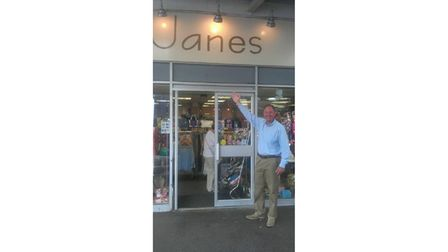 Picture of owner outside harbour shop