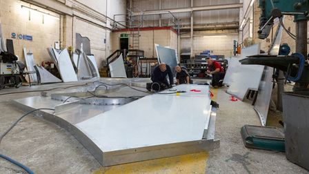 The Hudson Group team constructing the giant sign in Ipswich