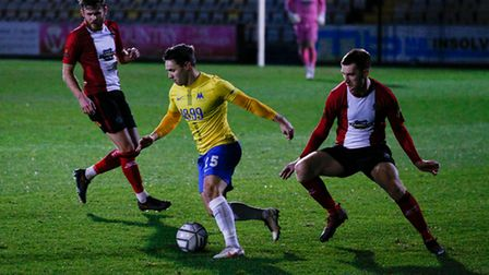 Billy Waters of Torquay United turns Tom Hannigan of Altrincham during the National League match bet