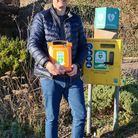 Rob James of Lyme Heartbeat with the defibrillator unit installed in Monmouth Beach car park