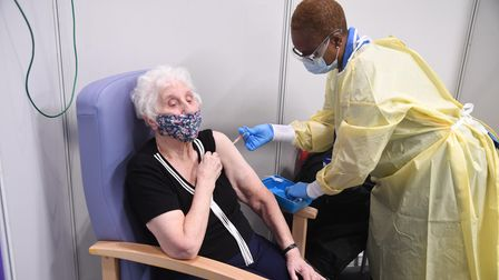 Colleen York receiving a Covid-19 vaccine at the NHS Nightingale facility at the Excel Centre, Londo