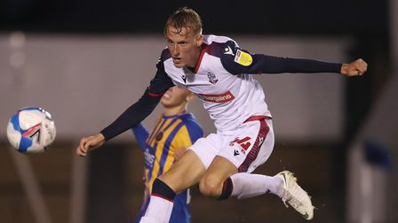 Bolton Wanderers' Regan Riley during the EFL Trophy match at Montgomery Waters Meadow, Shrewsbury.