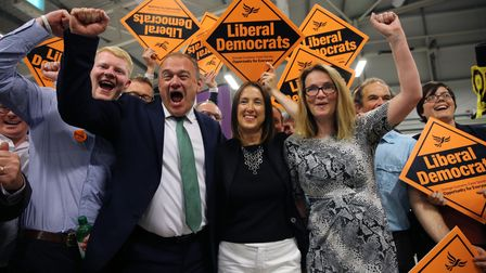 Ed Davey, now party leader, celebrates withJane Dodds (C)and her team, after she won the Brecon and Radnorshire...