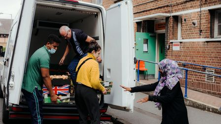 Mahad and Nimo help with the new delivery of food to the Banister House Community Hall, 25th August,