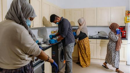 Shukri Adan and her brother Mahad prepare meals in Shukri's kitchen with the help of two friends.
