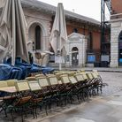 Tables and chairs from a closed restaurant business are stacked and tied together in the Covent Garden Piazza