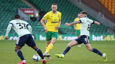 Marco Stiepermann of Norwich, Junior Hoilett of Cardiff City and Joe Ralls of Cardiff City in action