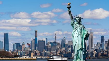 The Statue of Liberty over the Scene of New york cityscape river side which location is lower manhat