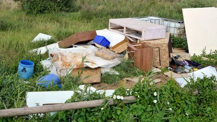 Fly-tipped household furniture, clearance and industrial waste dumped in the countryside.
