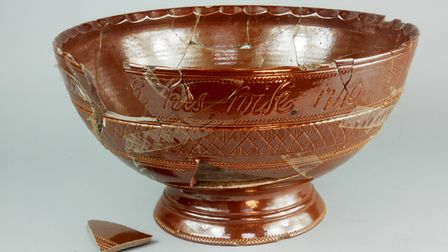 The 18th century marriage bowl had been poorly repaired, partially with sticky tape