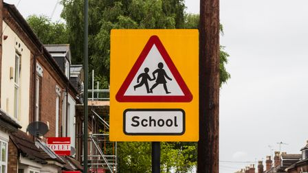 Warning traffic about school children crossing the road ahead