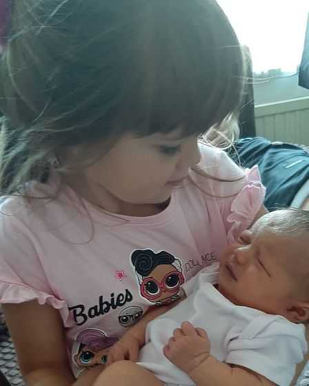 Sister holding baby