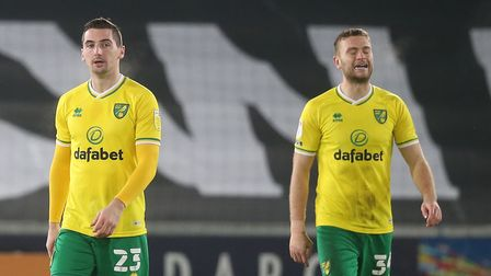 Kenny McLean and Ben Gibson of Norwich City show dejection after conceding the second goal during th