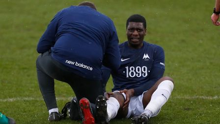 Torquay United player Josh Umerah is forced off with injury during the FA Trophy, 5th Round Match b