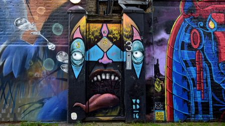 At street level, the buildings along Hawley mews are completely covered in street art