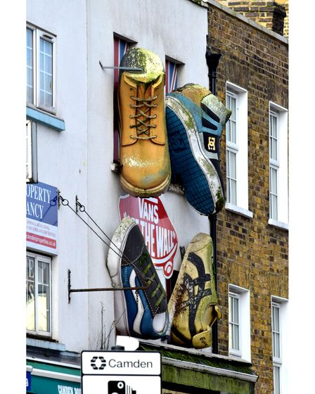 Giant shoes hang above 4 Feet