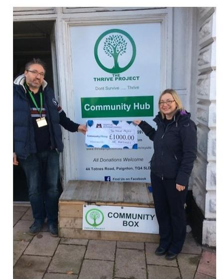 Picture of charity cheque presentation