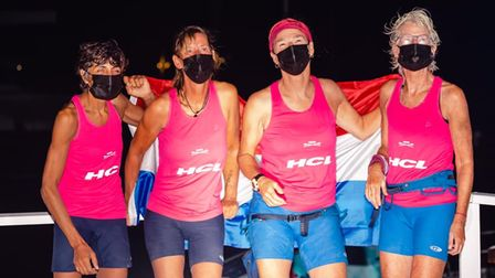 Thefour Dutchess of the Sea crew in face masks, pink vest tops and blue shorts