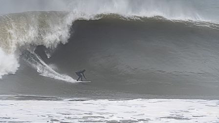 Surfers too to the beach at Croyde to enjoy the huge waves generated by the big Atlantic low