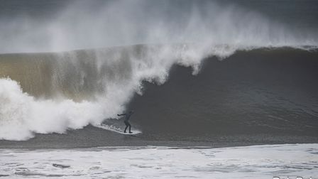 Surfing the big waves at Croyde