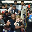 James Cook MBE with young boxers in the gym at Pedro Boxing Club