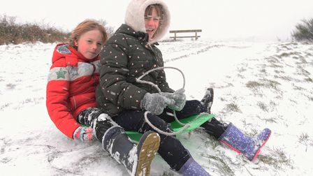 Betsy and Sonny Parkinson sledging on Mousehold Heath. Picture: Danielle Booden