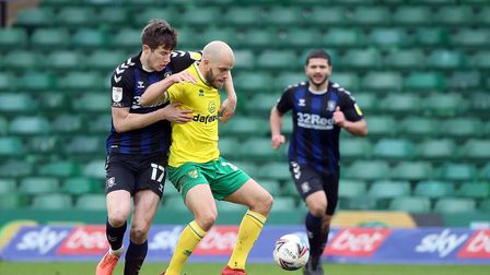 Paddy McNair of Middlesbrough and Teemu Pukki of Norwich in action during the Sky Bet Championship m