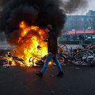 Rising anger:Protesters lay bikes down to block a street and set a fire during a protest against the coronavirus measuresin Eindhoven in January