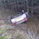 A driver was taken to hospital after their car crashed andoverturned in a water-filled dyke on the A1101 at Sutton Road...