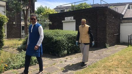Father and son, Dabirul and Atique Choudhury, walk in Bow.