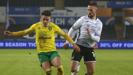 Max Aarons of Norwich City and Conor Hourihane of Swansea City battle for the ball during the Sky Be