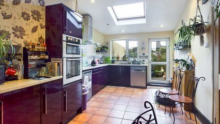 The kitchen is fitted with a comprehensive range of modern units