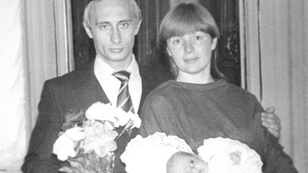 Vladimir Putin seen with his wife Lyudmila and daughter Maria. (Photo by TASS via Getty Images)