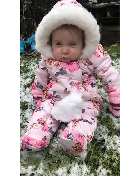 Baby Rose Alice Regan in Rainham isn't too sure if she likes her first snow experience.