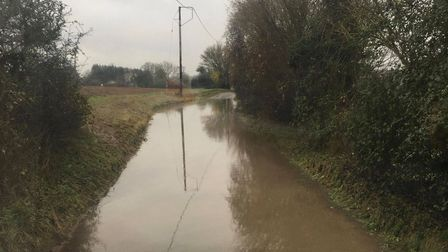 Floods in Broxted Road, Great Easton. Picture: LOU PAINTER