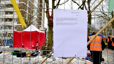 """A new sign on the fence as """"tree protectors"""" are evicted from Dixon Clark Court at Highbury Corner"""
