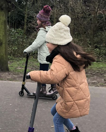 Nine-year-old Polly Anderson and her seven-year-old sister Robyn Symons are gearing up to scoot 30 miles to raise cash for...