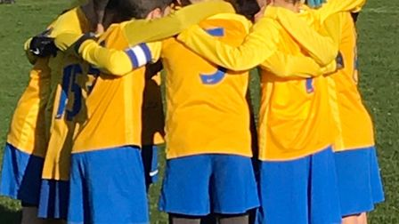 St Albans City Youth players in a huddle