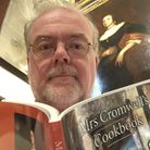Cromwell Museum curator Stuart Orme with the newly revised cookbook.