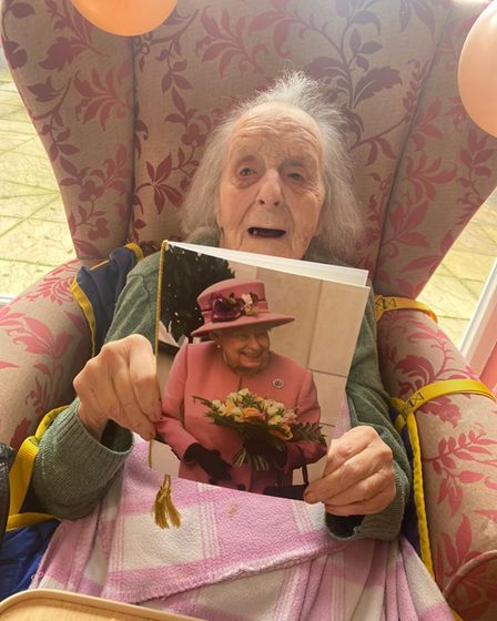 Olive Lord with a card from the Queen on her birthday.