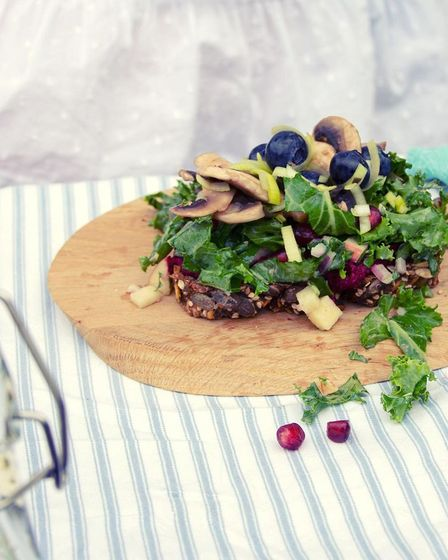 On the menu will be open sandwiches made using plant-based toppings on homemade rye bread. This one has beetroot hummus, kale, apple salad, mushrooms and  blueberries.