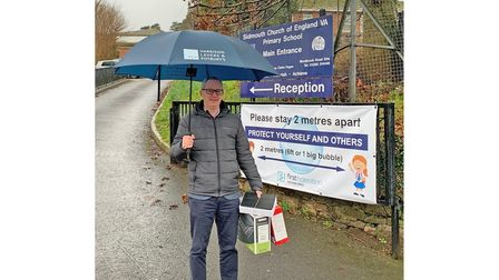 Tony Sutherland, director of Harrison-Lavers and Potburys, with some laptops for Sidmouth Primary School
