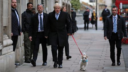 Prime Minister Boris Johnson arrives with his dog Dilyn to cast his vote in the 2019 General Electio