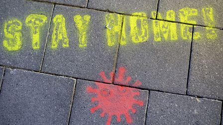 """A graffiti consisting of the text """"Stay Home"""" and a symbolic novel coronavirus has been sprayed on t"""